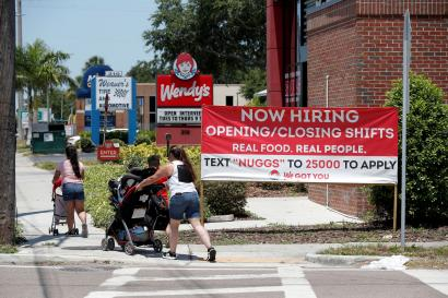"""A Wendy's restaurant displays a """"Now Hiring"""" sign in Tampa, Florida, U.S., June 1, 2021."""