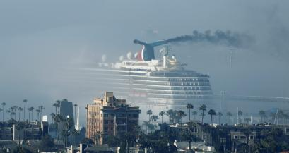 The cruise ship Carnival Miracle sits in the fog at the port of the Long Beach during the outbreak of the coronavirus disease