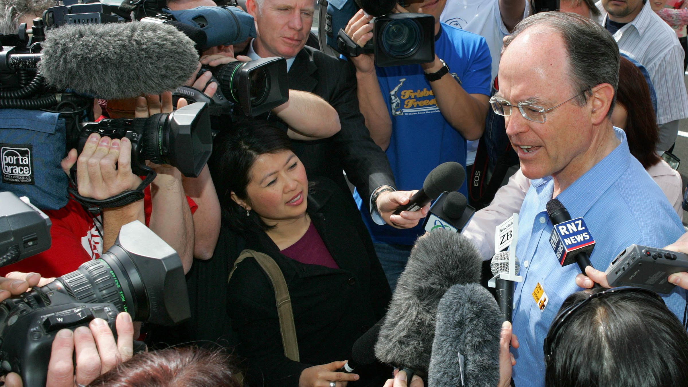 Don Brash talks to the media after casting his vote in Auckland during New New Zealand's general election in 2005