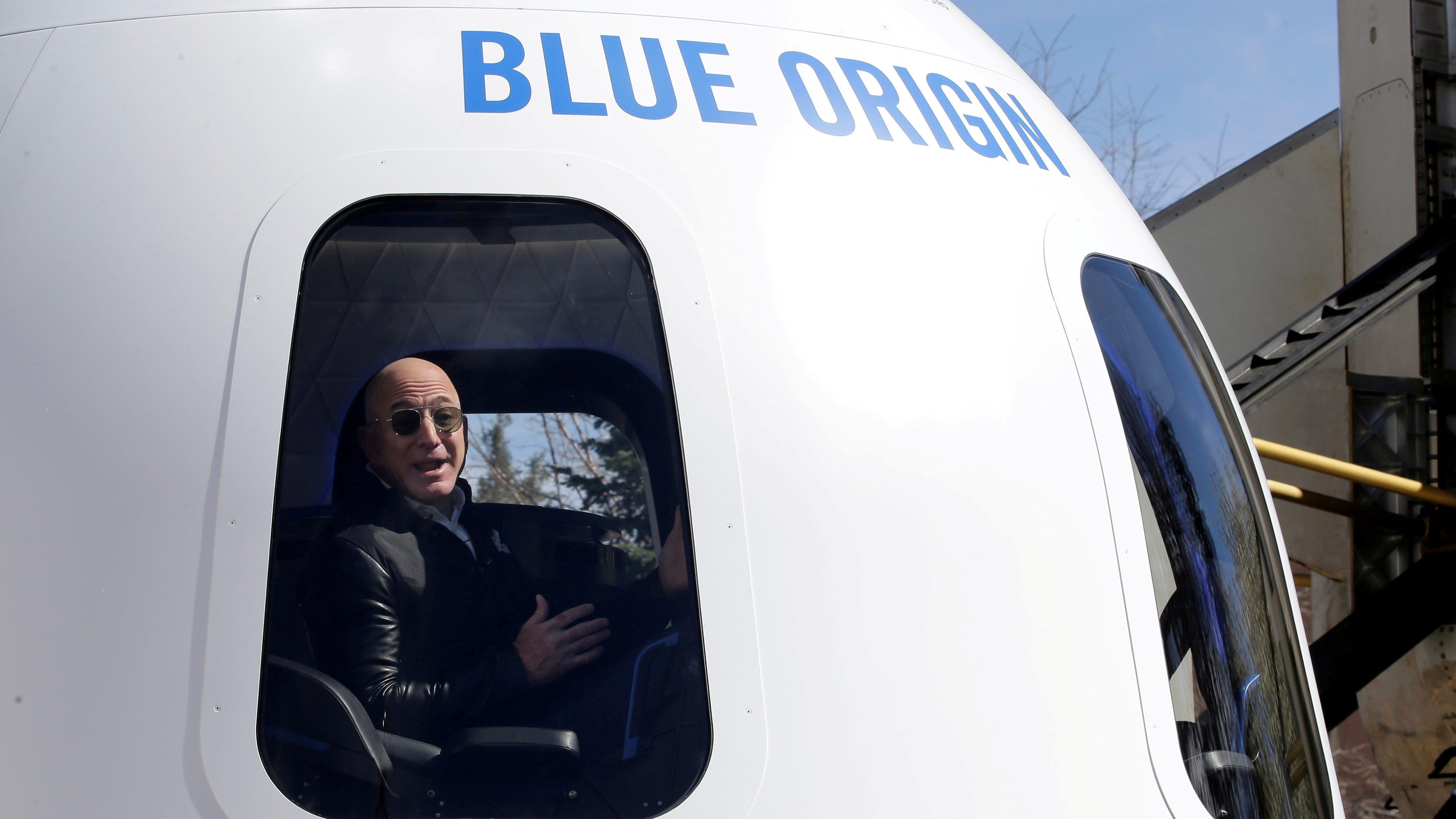 Jeff Bezos is seen inside a Blue Origin spacecraft