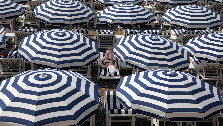 Striped beach umbrellas in Nice, France
