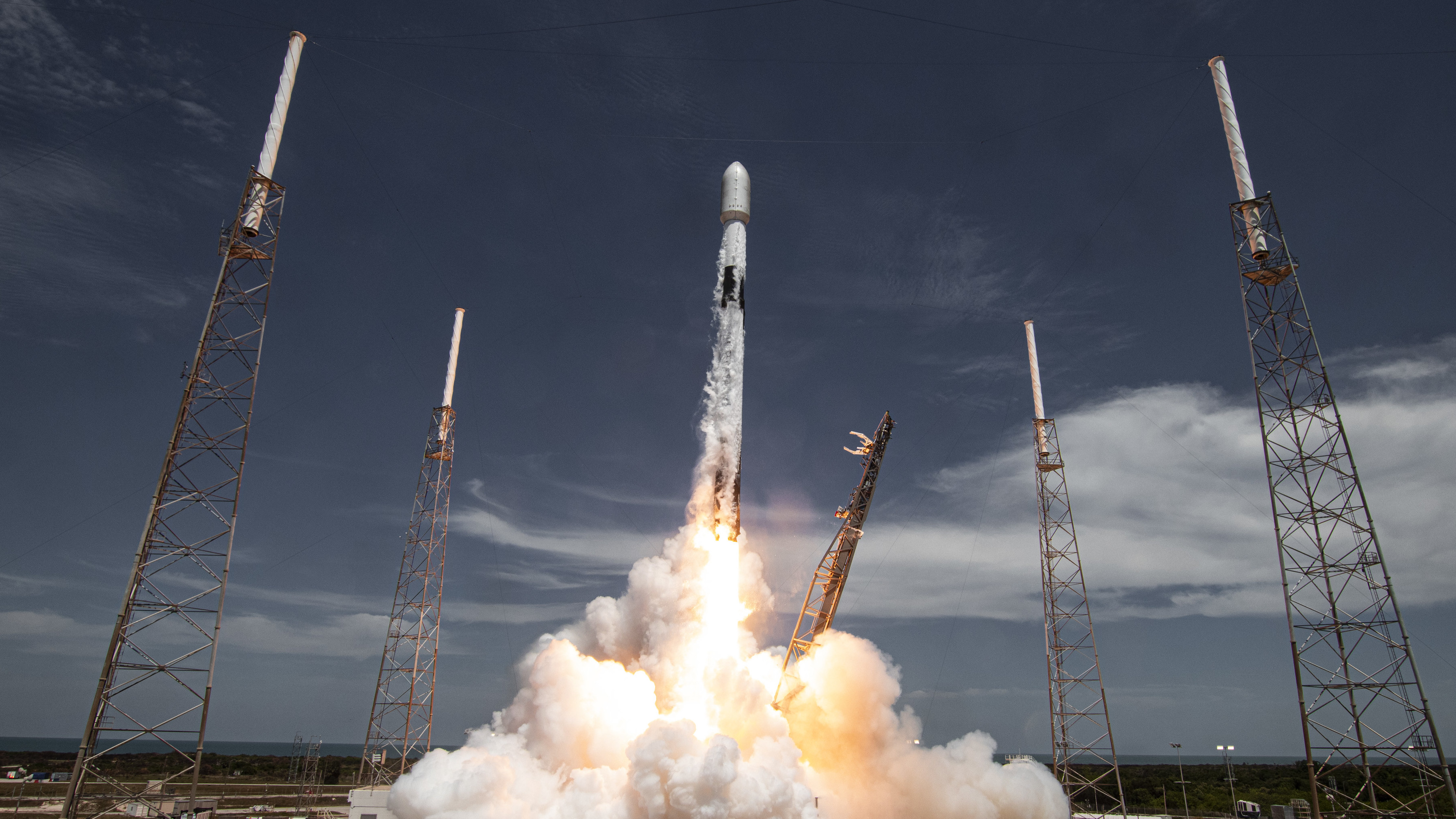 A SpaceX Falcon 9 rocket launches satellites in 2021.