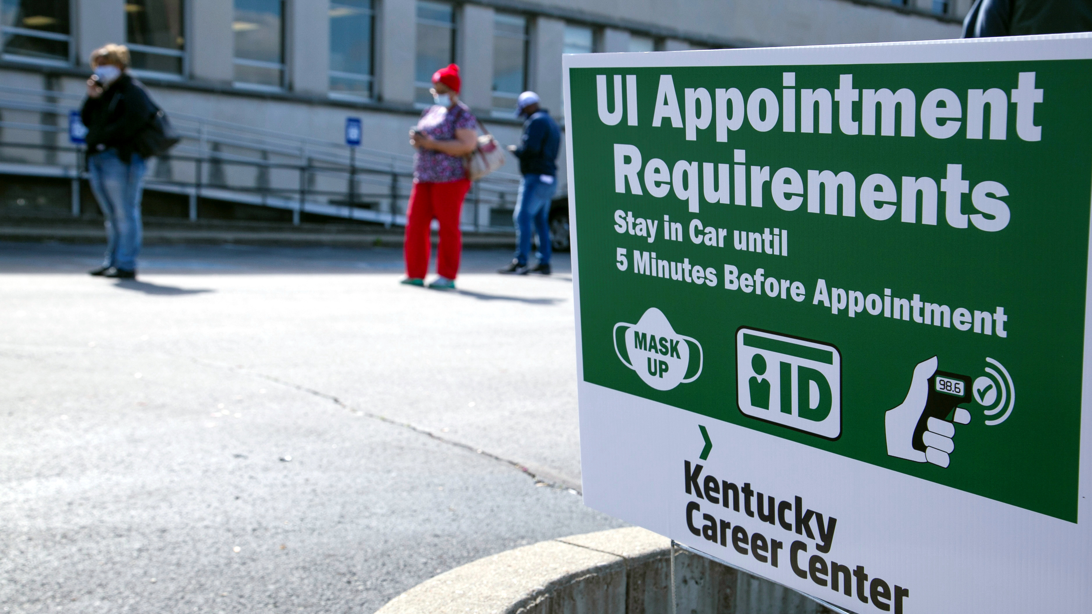 People wait in line as Kentucky Labor Cabinet reopens 13 Regional Career Centers for in-person unemployment insurance services, in Louisville, Kentucky, U.S.