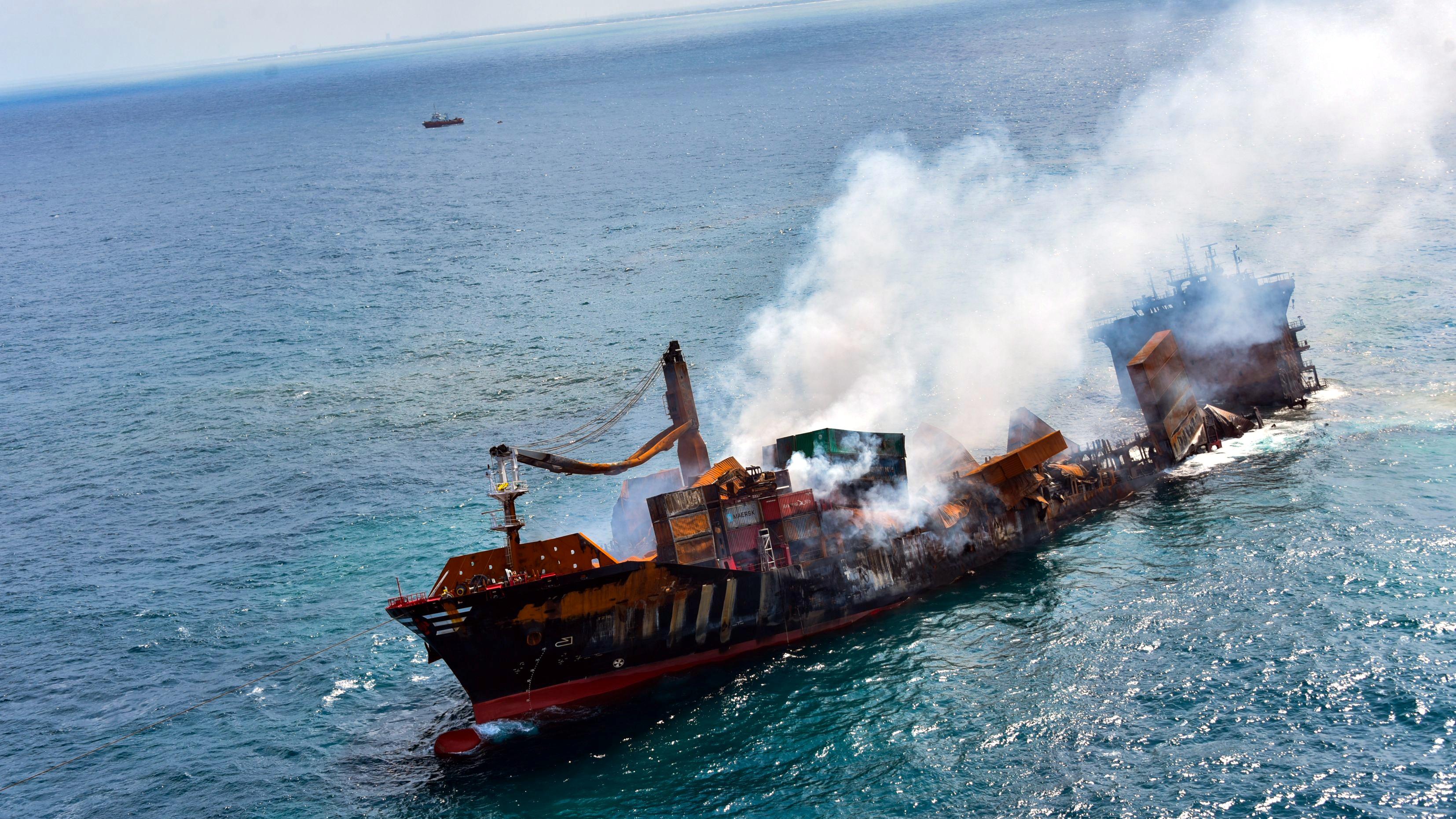 Smoke rises from a fire onboard the MV X-Press Pearl vessel as it sinks