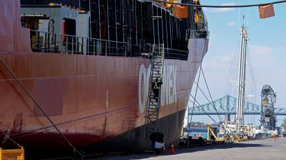 A crew member boards a cargo ship in in Montreal, Quebec in May 2021