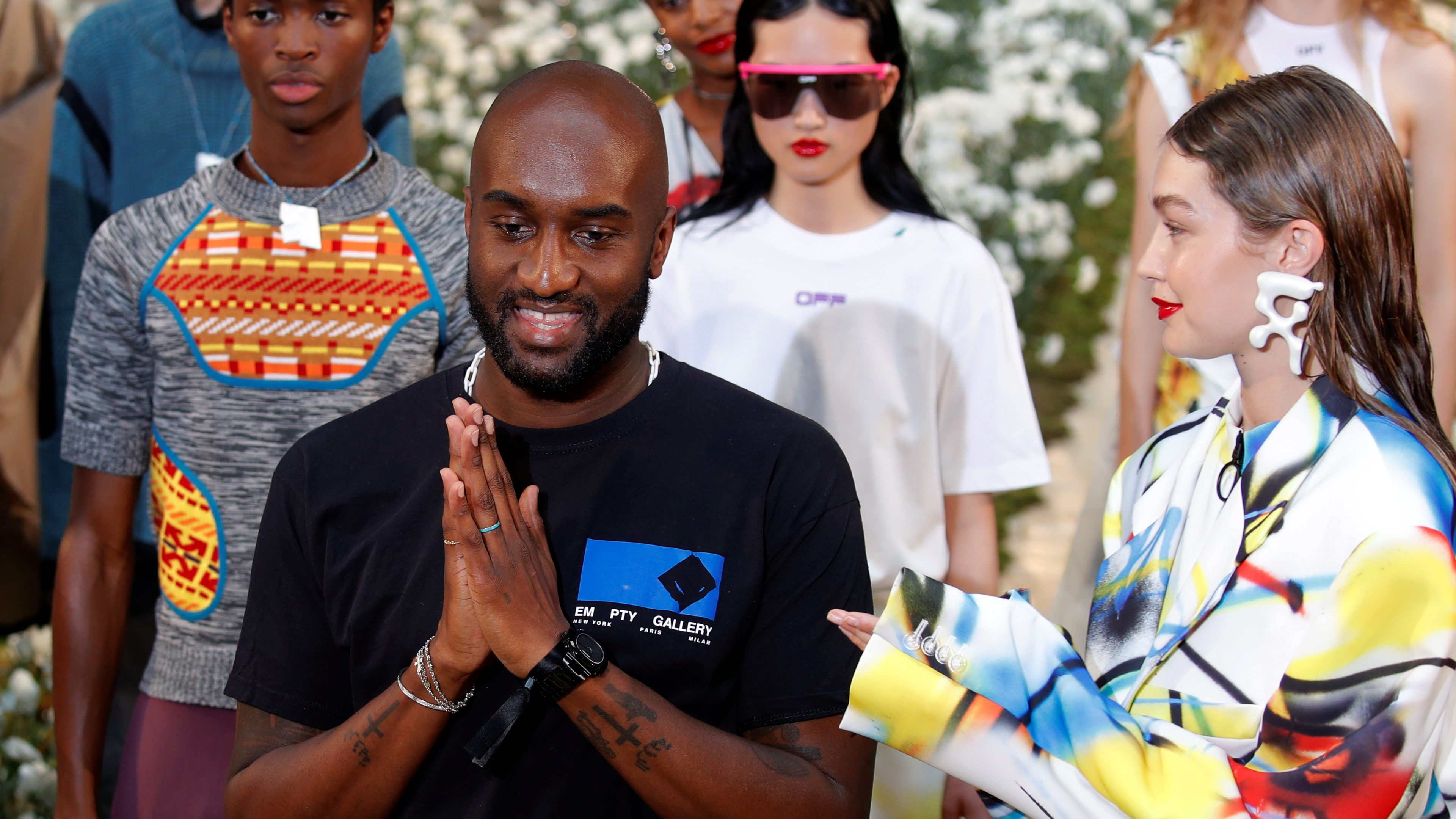 Designer Virgil Abloh appears with model Gigi Hadid at the end of his Spring/Summer 2020 collection show for his label Off-White in Paris