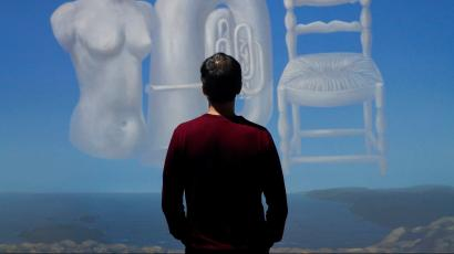 """A museum assistant poses in the """"Cloud Room"""" inspired by the painting """"Threatening Weather"""" by Belgian surrealist artist Rene Magritte during the exhibition """"Dali & Magritte"""" at the Royal Museums of Fine Arts of Belgium in Brussels, October 11, 2019."""