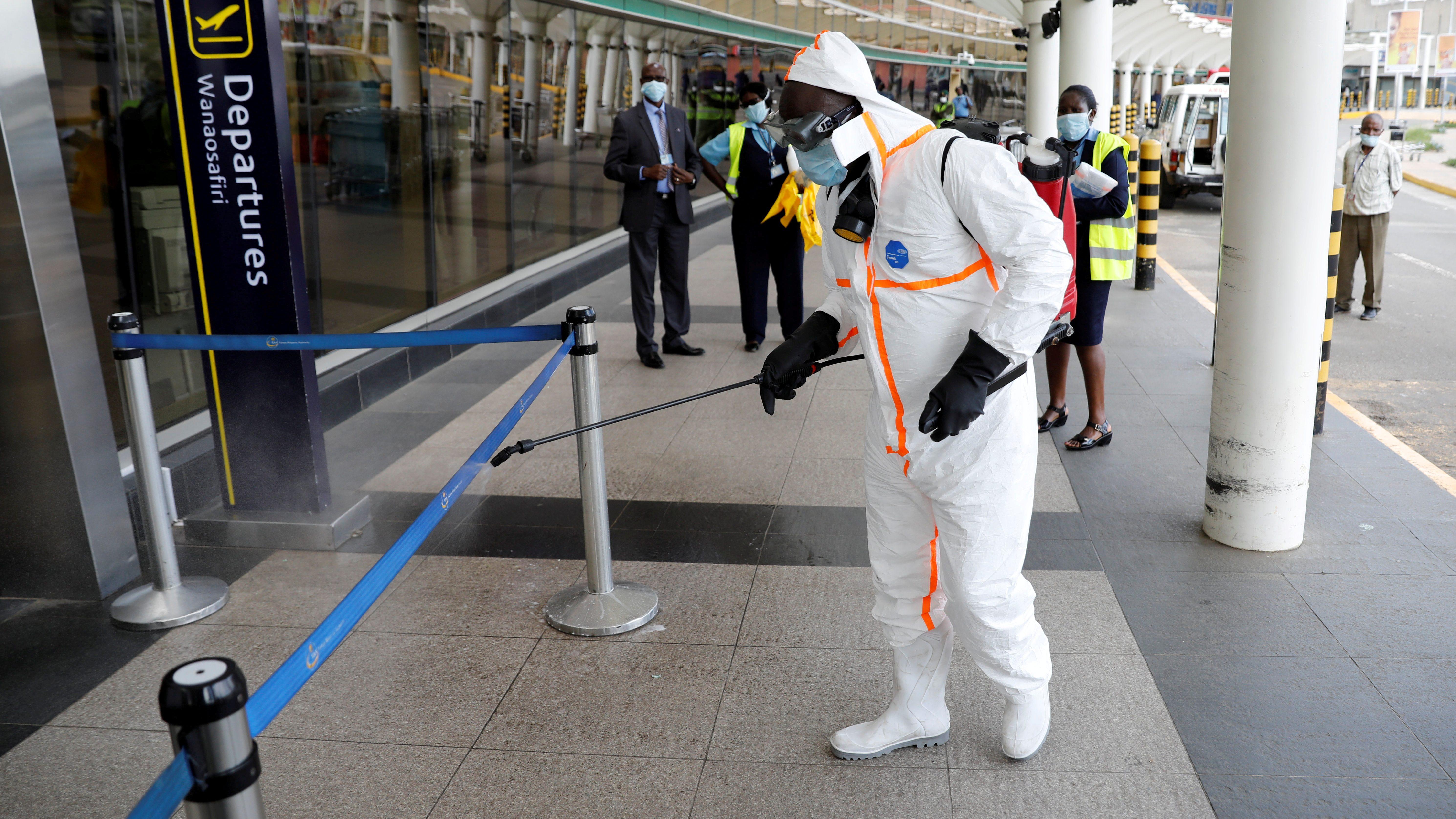 A health worker sprays disinfectant to prevent a Covid-19 outbreak at the Jomo Kenyatta International Airport in Nairobi, Kenya.