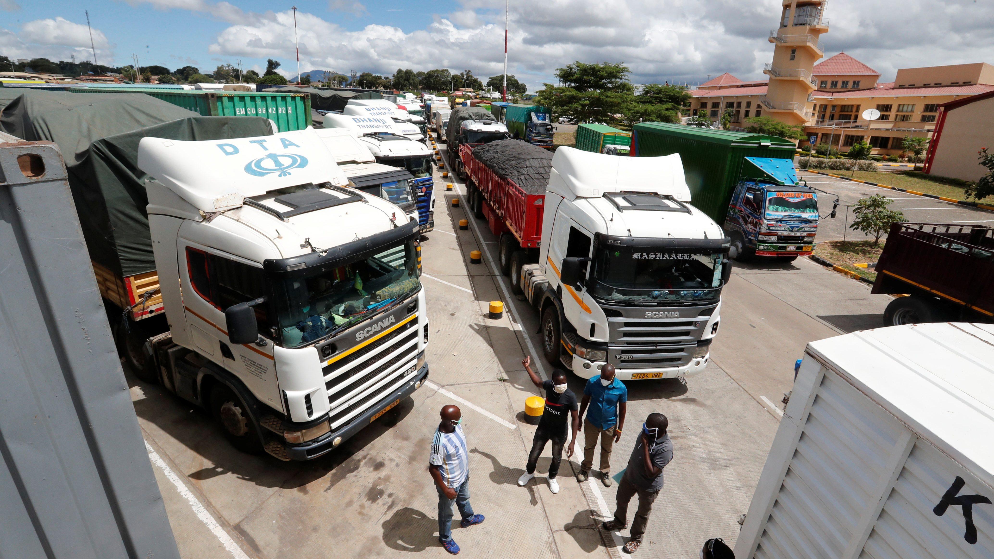 Truck drivers near their parked vehicles at the Namanga border crossing point between Kenya and Tanzania in Kenya.