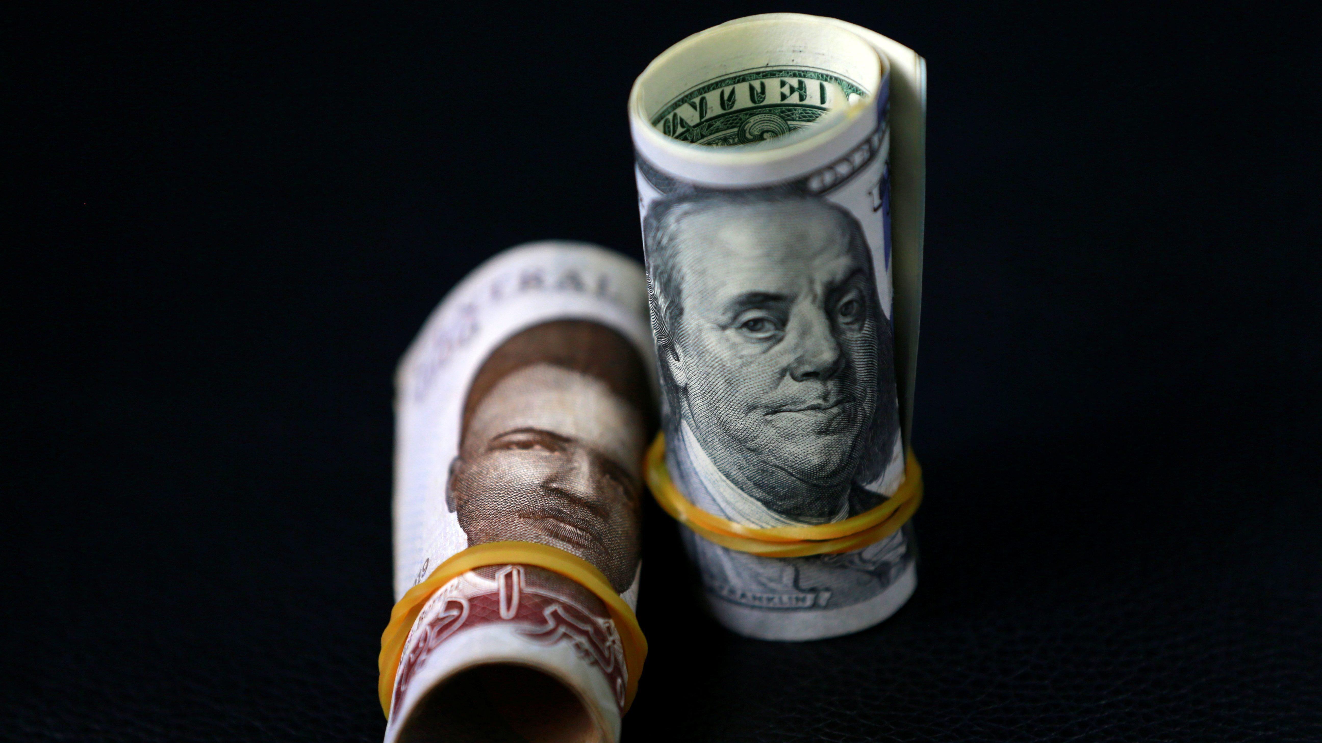 A Nigerian naira and an American dollar banknote.
