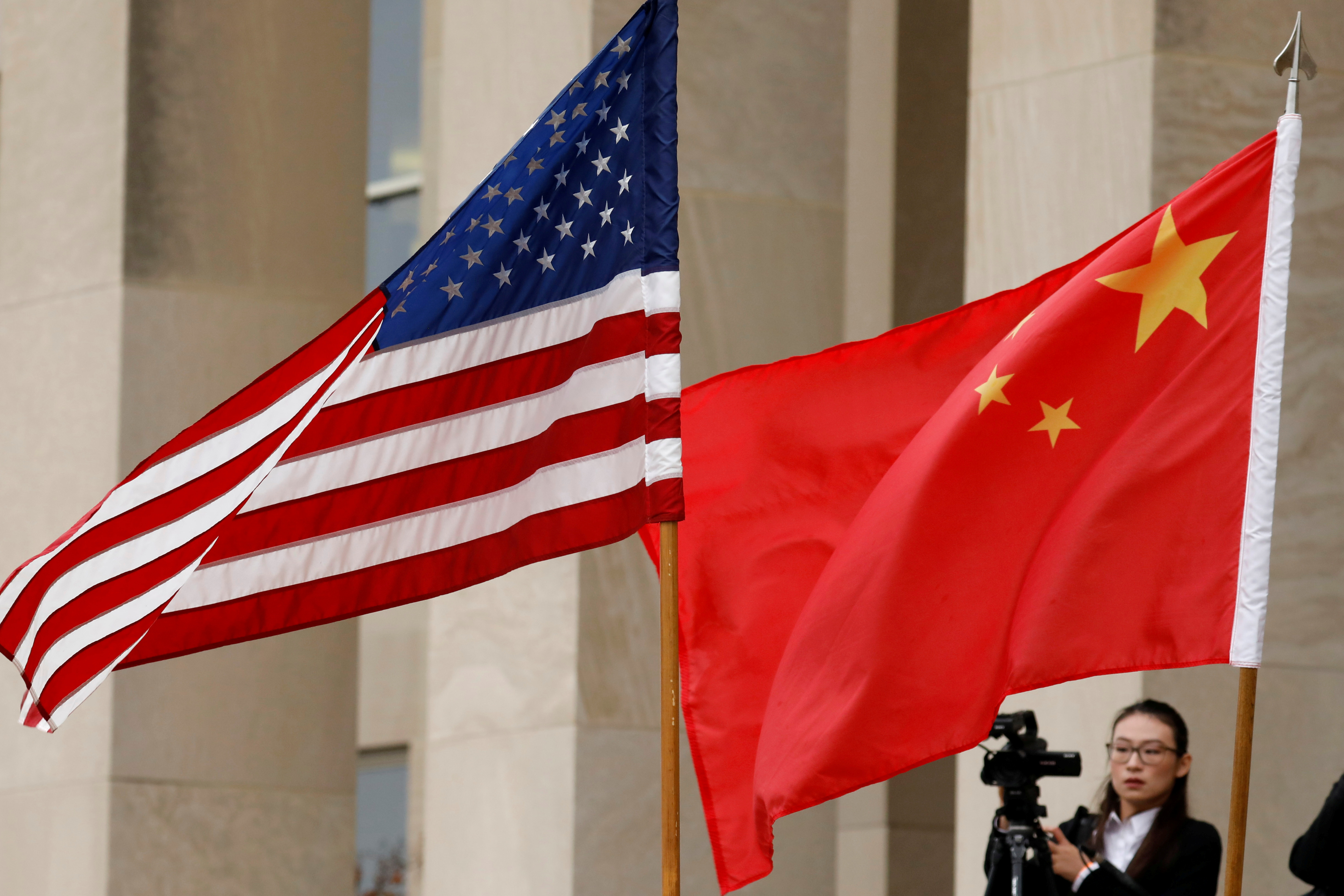 FILE PHOTO: U.S. and Chinese flags are seen before a meeting between senior defence officials from both countries at the Pentagon in Arlington, Virginia, U.S., November 9, 2018. REUTERS/Yuri Gripas/File Photo