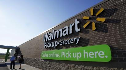 People talk outside a Wal-Mart store's grocery pickup.