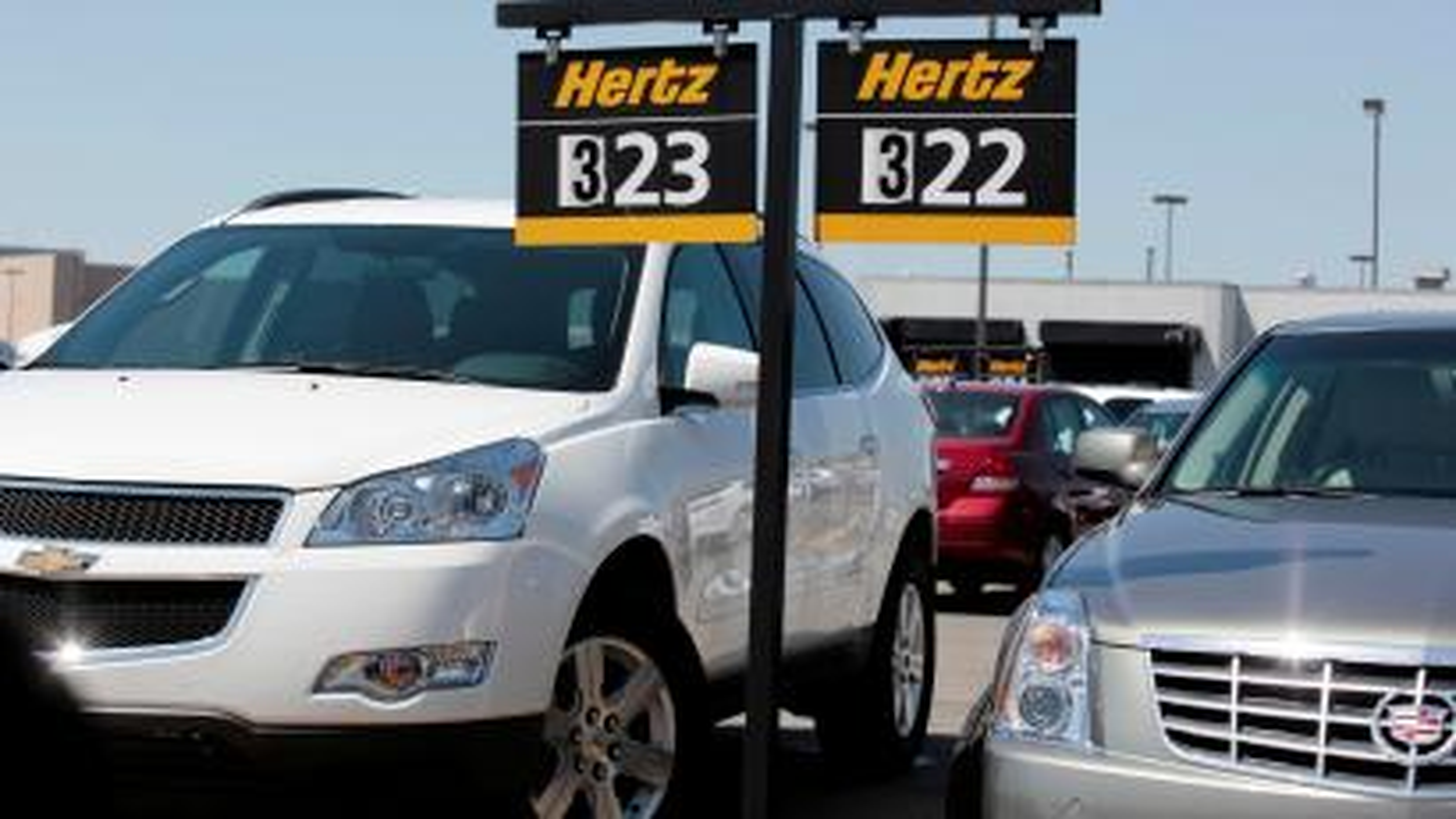 Hertz rental cars are parked in a rental lot near Detroit Metropolitan airport