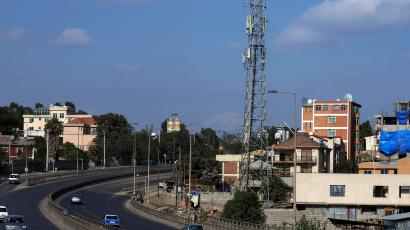 Motorists drive past an Ethio-Telecom network tower in Addis Ababa, Ethiopia.