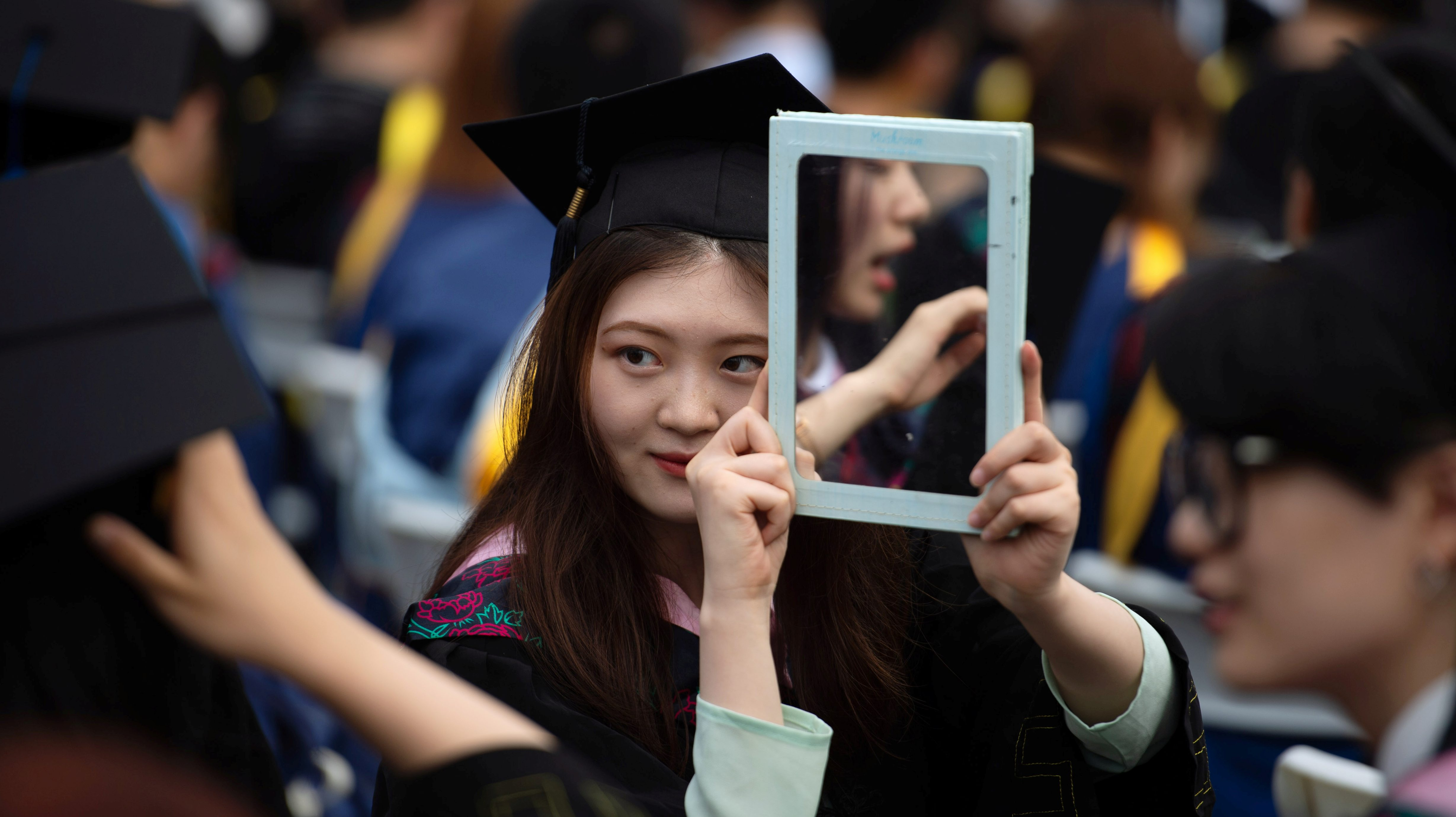 Graduates, including students who could not attend last year due to the coronavirus disease (COVID-19) pandemic, attend a graduation ceremony at Central China Normal University in Wuhan, Hubei province, China June 13, 2021. Picture taken June 13, 2021. REUTERS/Stringer CHINA OUT.