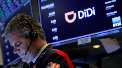 A trader works during the IPO for Chinese ride-hailing company Didi Global Inc on the New York Stock Exchange (NYSE) floor in New York City, U.S., June 30, 2021.