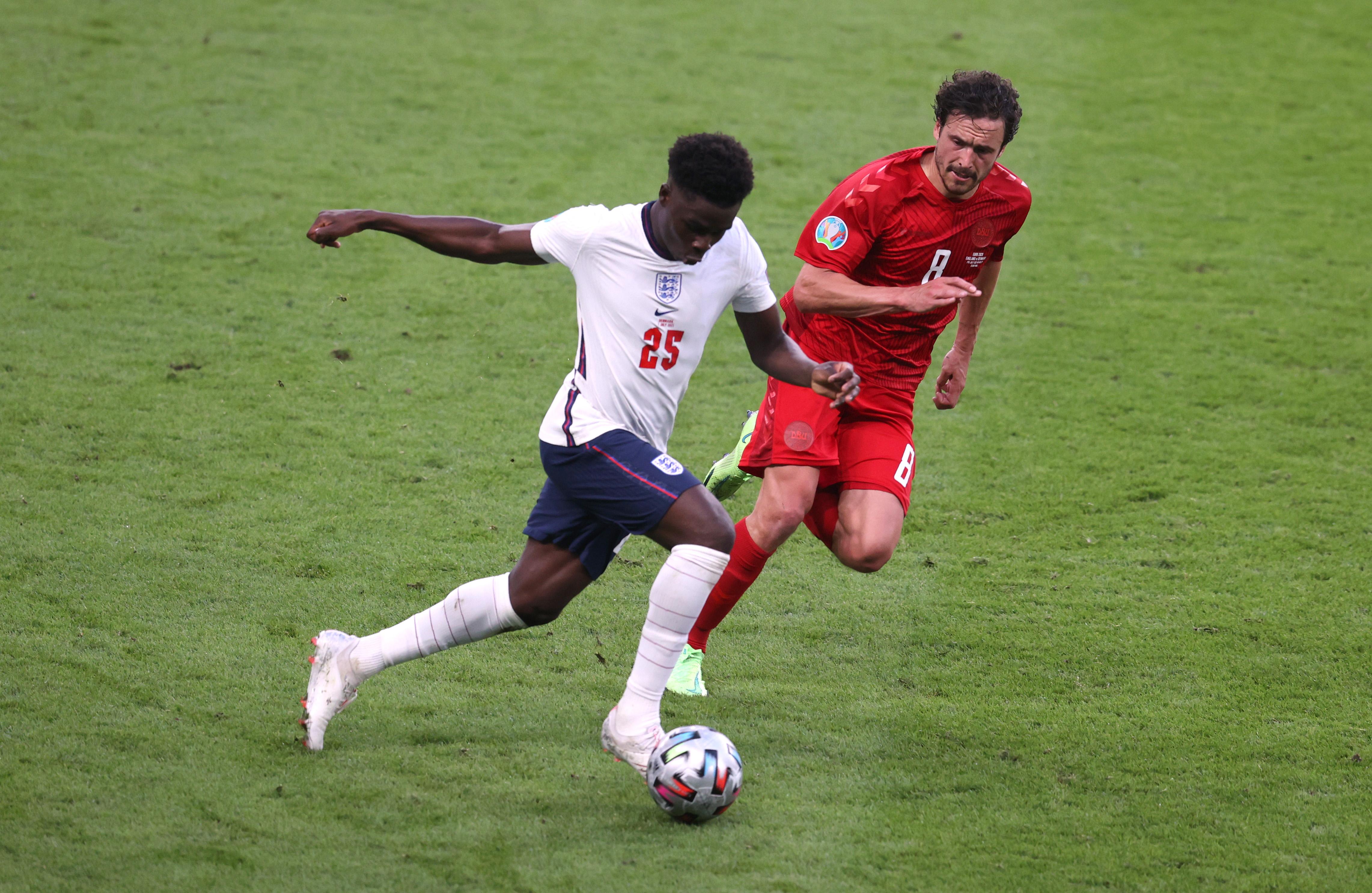 Bukayo Saka playing for England against Denmark.