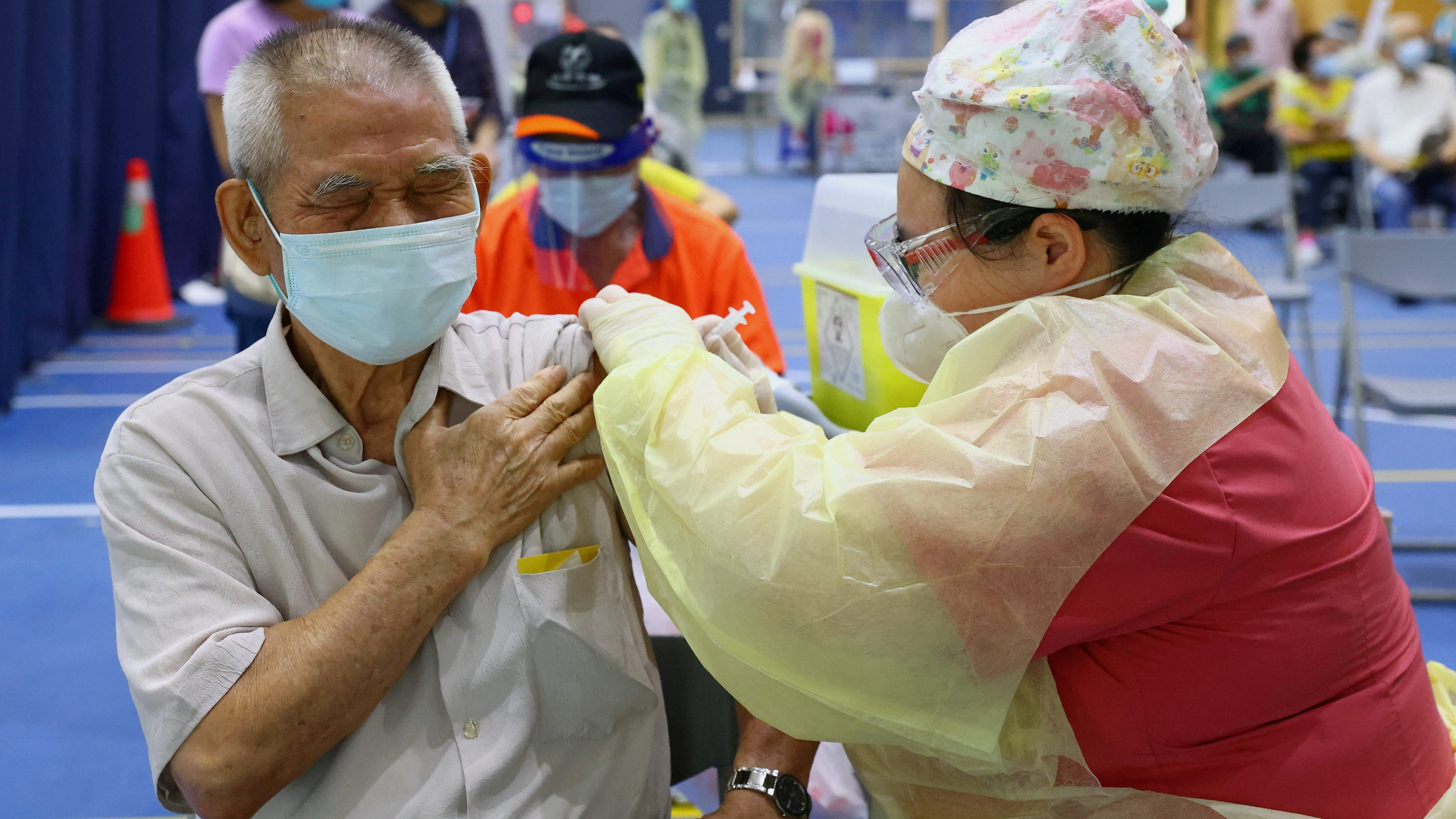 FILE PHOTO: A medical worker administers a dose of the AstraZeneca vaccine against the coronavirus disease (COVID-19) to a man during a vaccination session for elderly people over 75 years old, at a stadium in New Taipei City, Taiwan June 25, 2021.