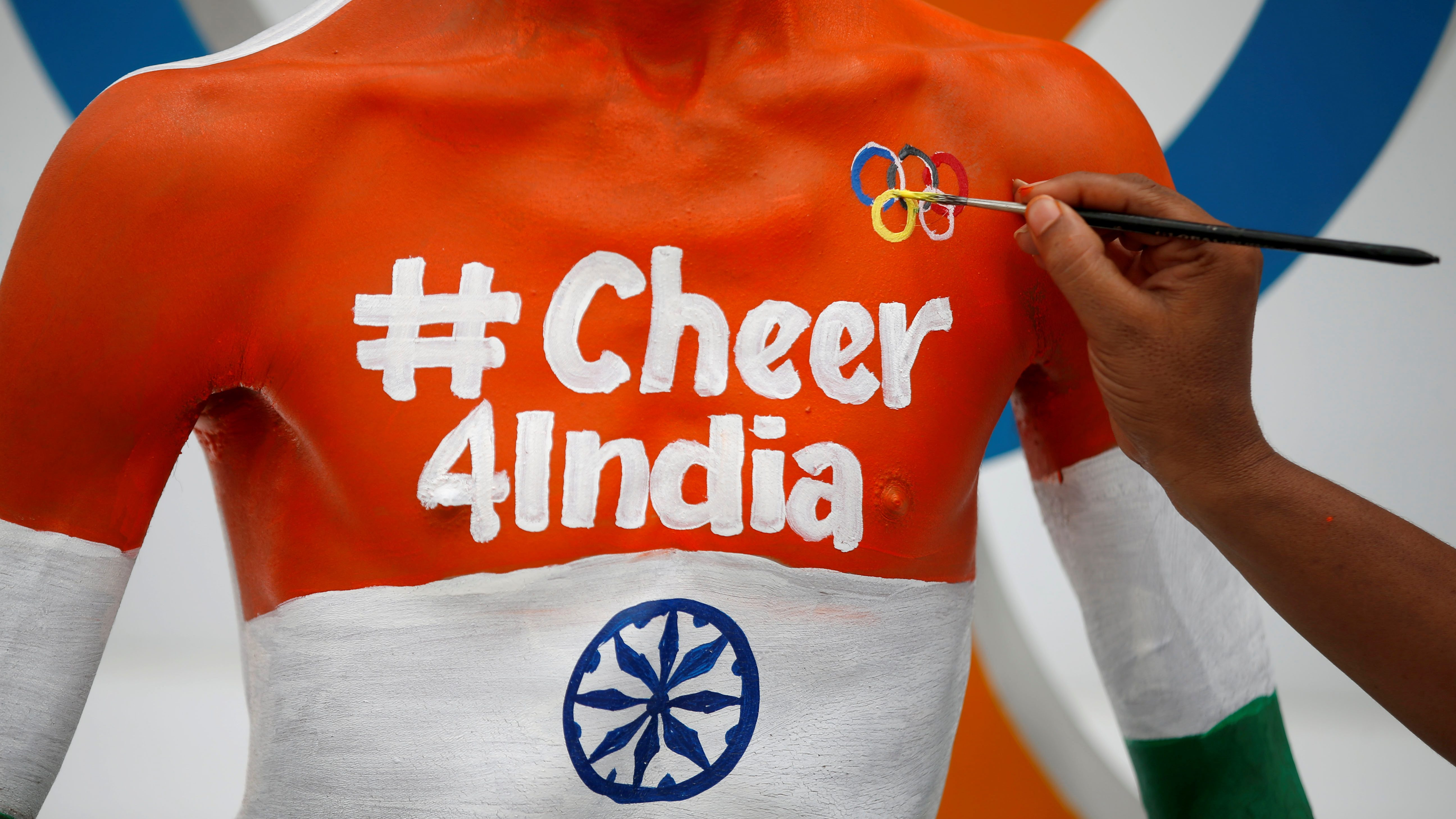 Arun Haryani has the Olympic rings painted on his body as he cheers on India's team for the Tokyo 2020 Olympics, in Ahmedabad