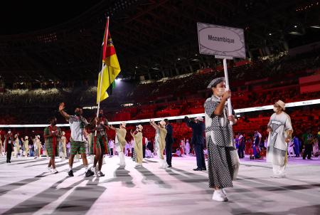 Flag bearers Kevin Loforte of Mozambique and Rady Adosinda Gramane of Mozambique lead their contingent during the athletes' parade at the opening ceremony of the Tokyo Olympics.