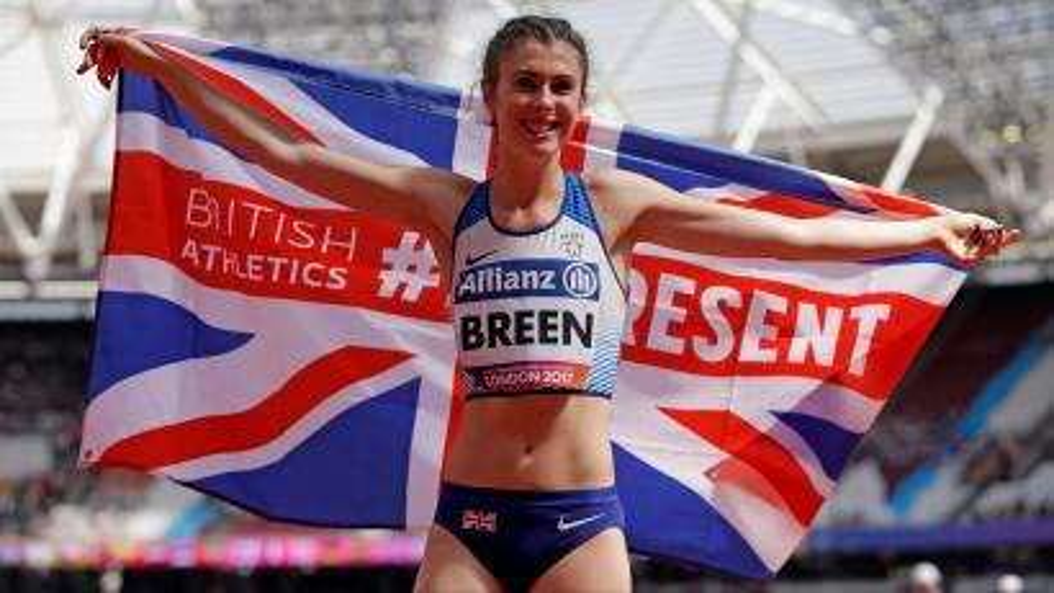 Olivia Breen holds a UK flag.