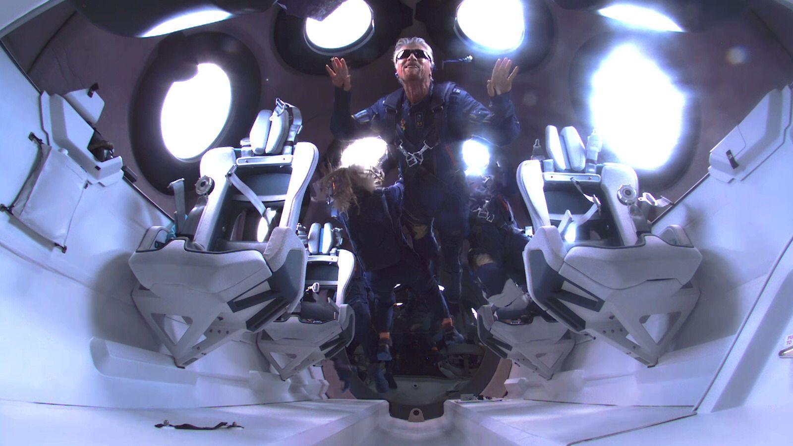 Richard Branson floats in microgravity inside Virgin Galactic's spaceplane.