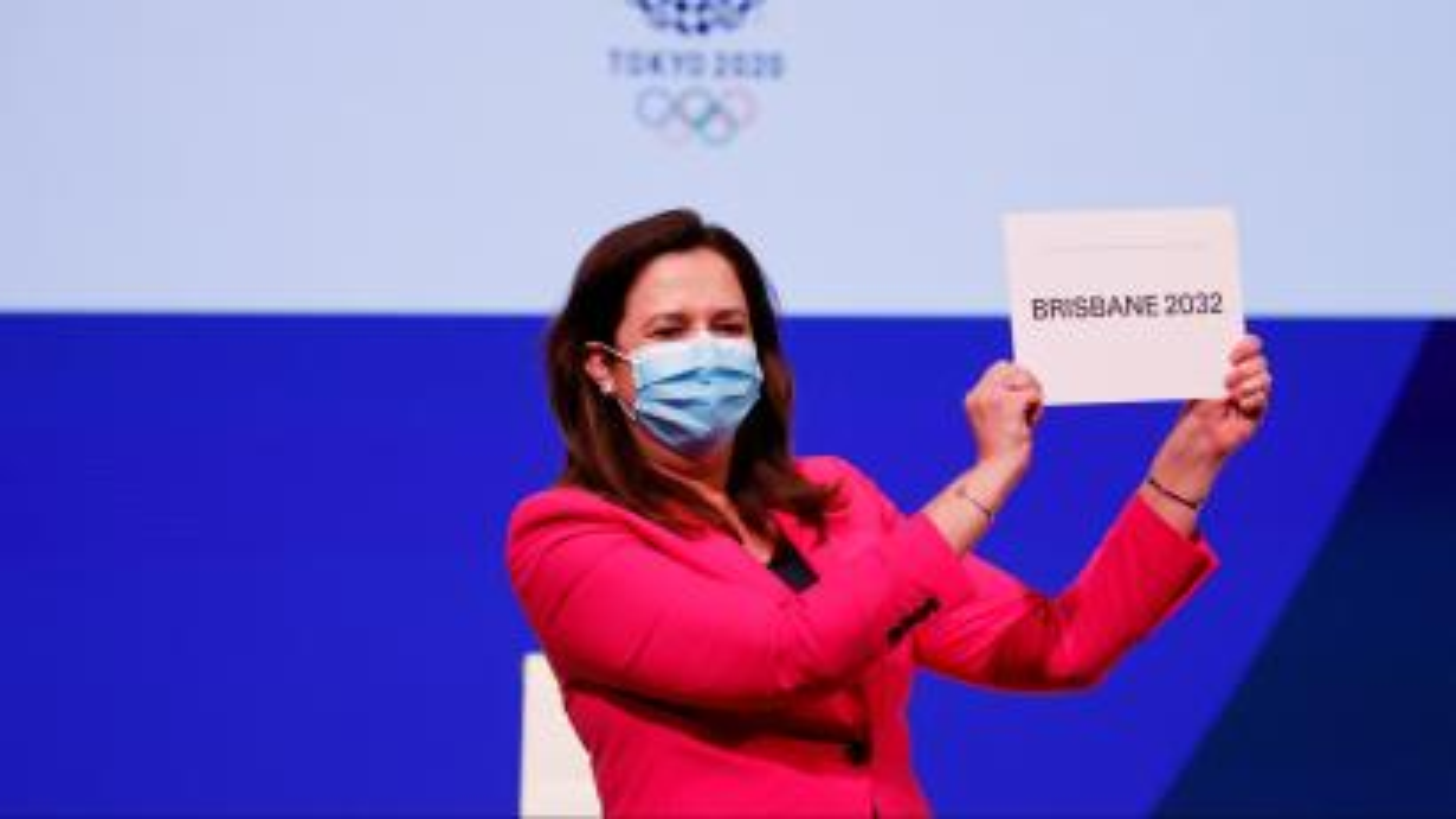 "Premier of Queensland Annastacia Palaszczuk holds a sign that reads ""Brisbane 2023."""