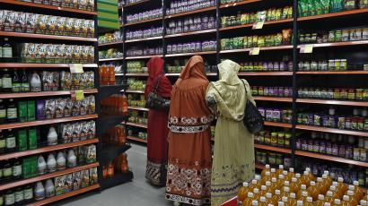 A photograph of people shopping in a grocery store