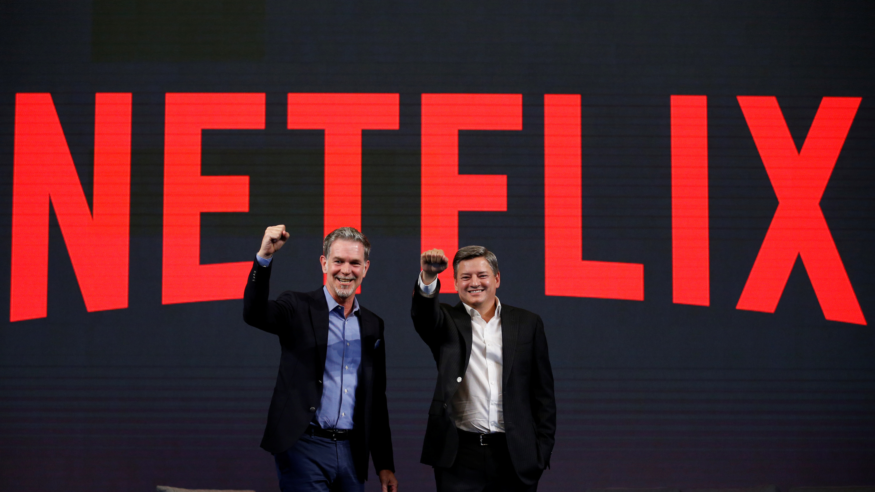 Netflix co-CEOs Reed Hastings and Ted Sarandos pose for a photo