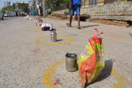 A photograph taken in April 2020 shows bags and utensils placed by migrant workers outside a school in Delhi where the government was distributing rations during the coronavirus lockdown.