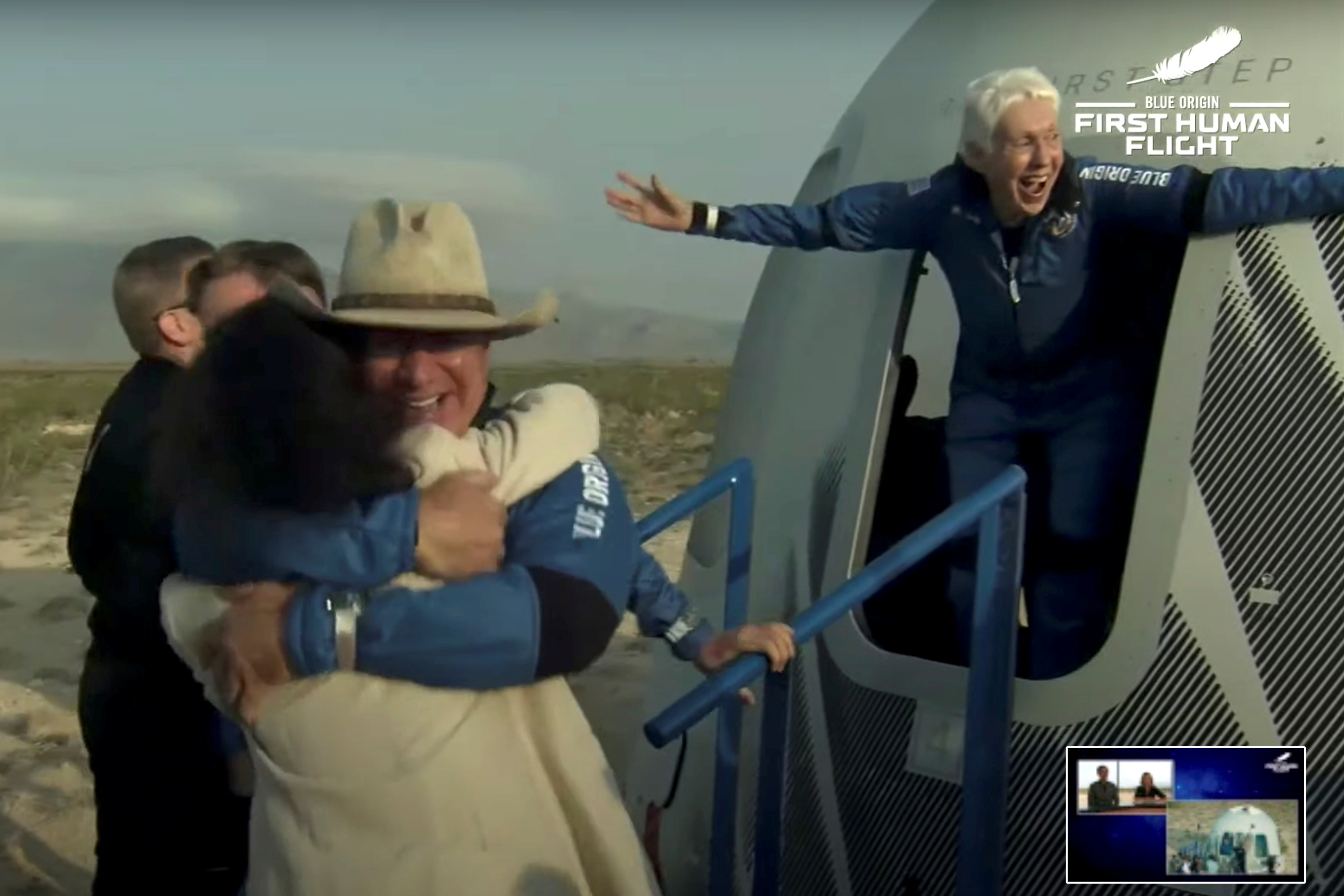 Wally Funk spreads her arms as she exits the New Shepard capsule
