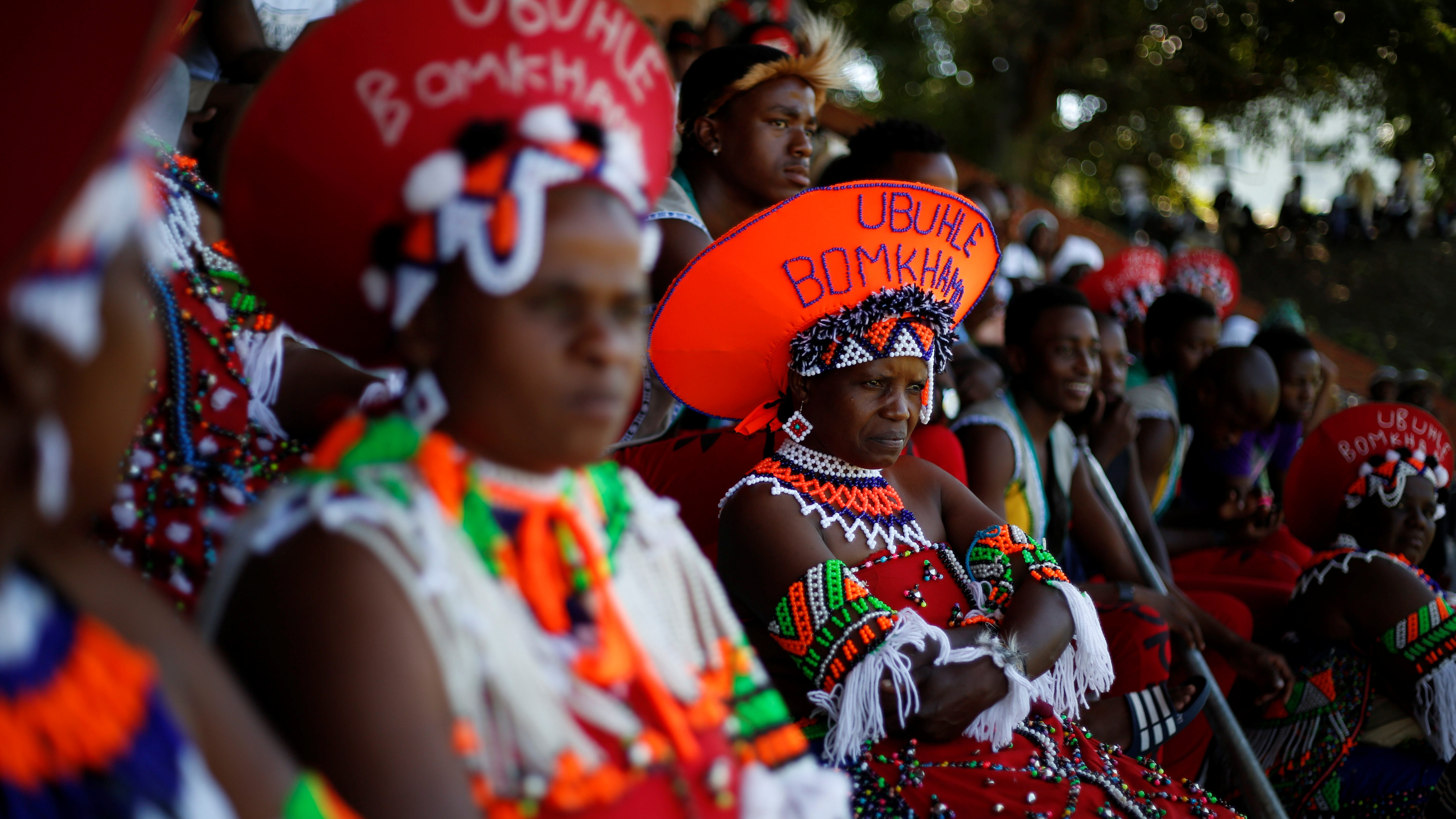 Contestants watch others perform during a Zulu dance competition in Durban.