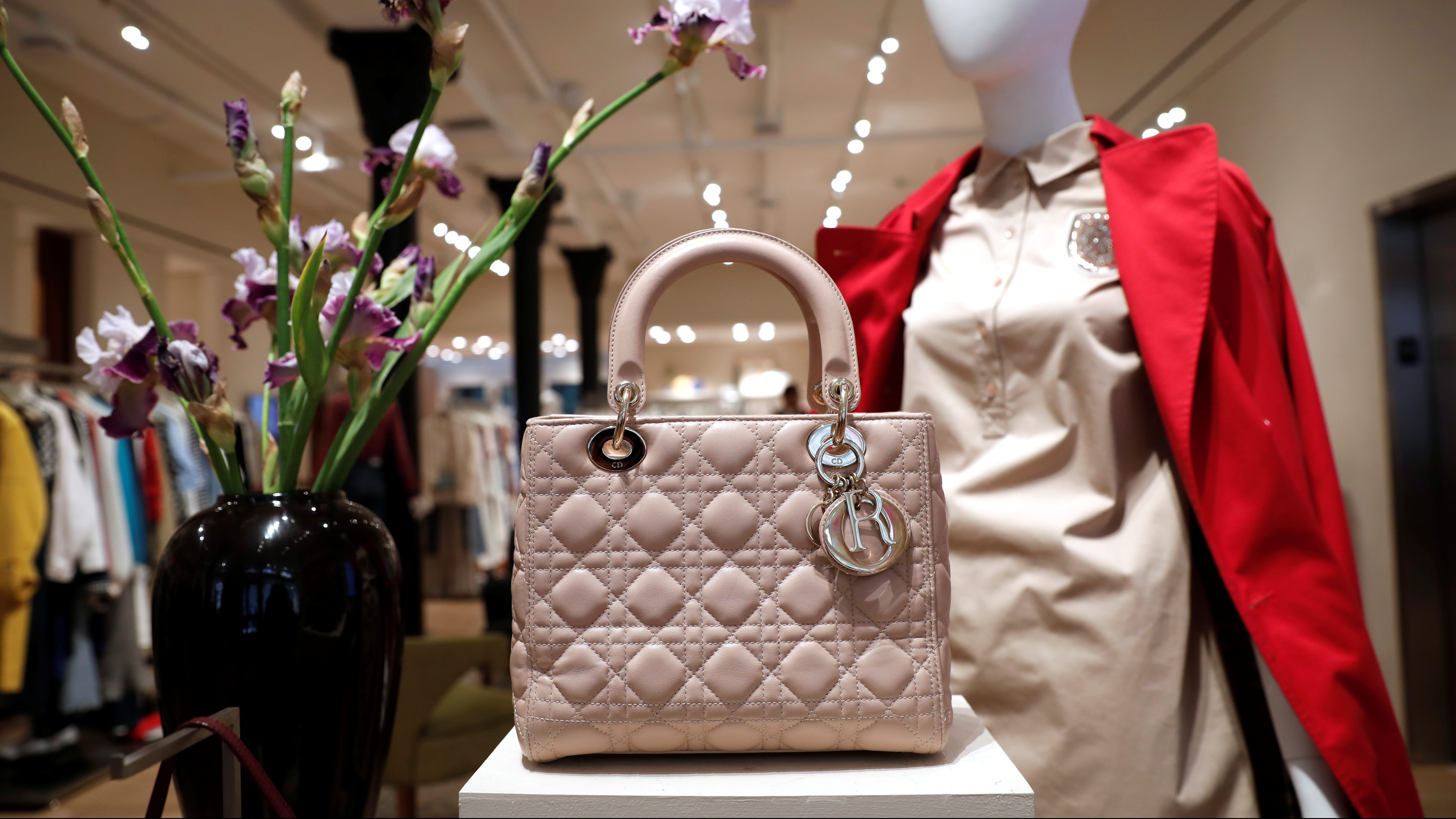 Luxury items for sale are displayed at The RealReal shop
