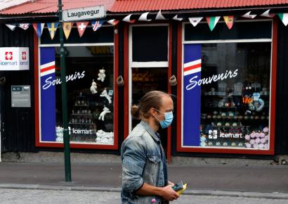 A man wears a surgical mask on the streets of Reykjavik, Iceland.