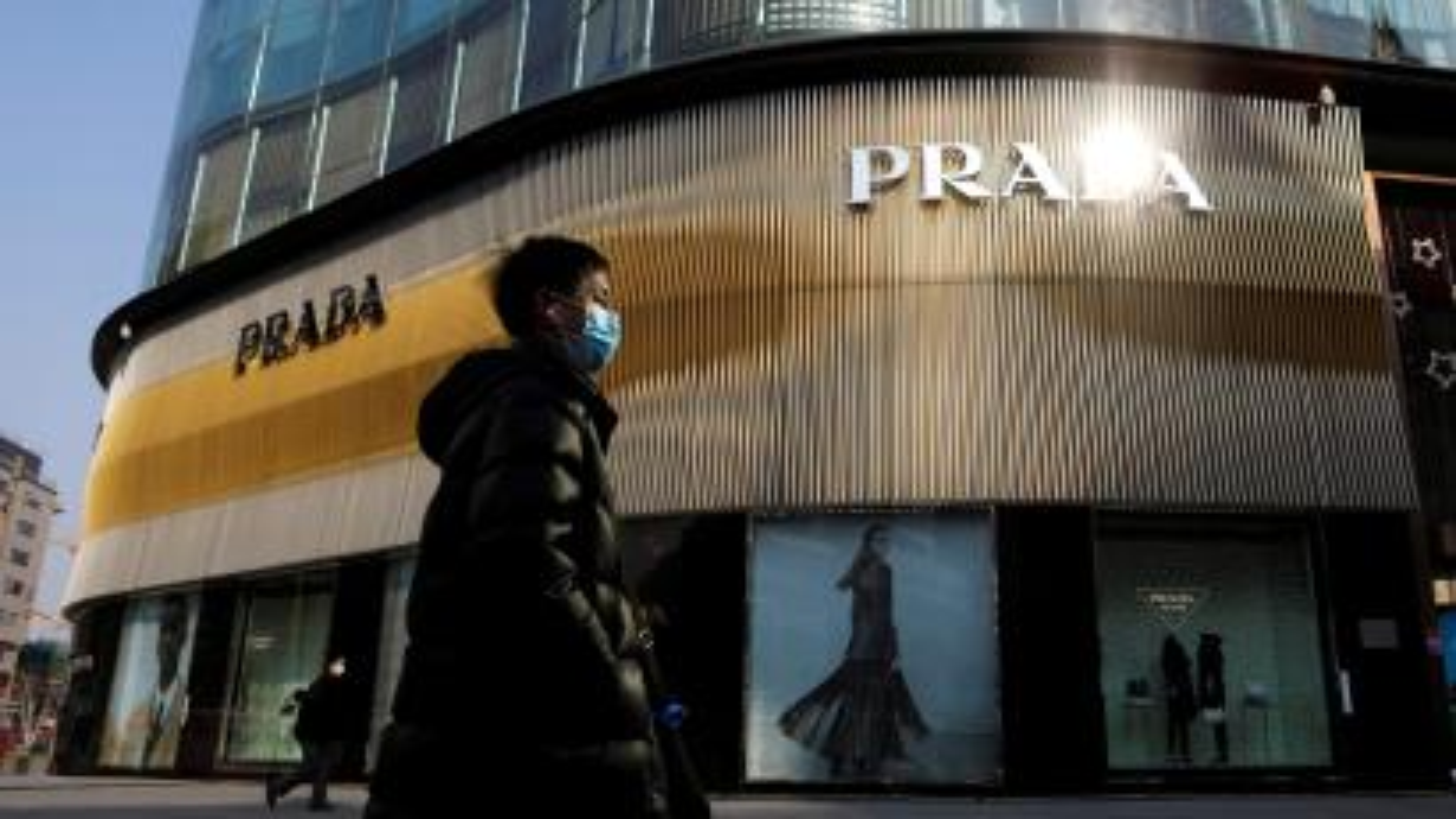 A man walks past a Prada store in Beijing