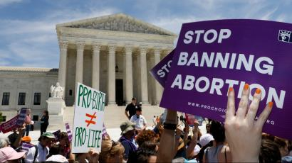 Abortion rights activists rally outside the U.S. Supreme Court in Washington