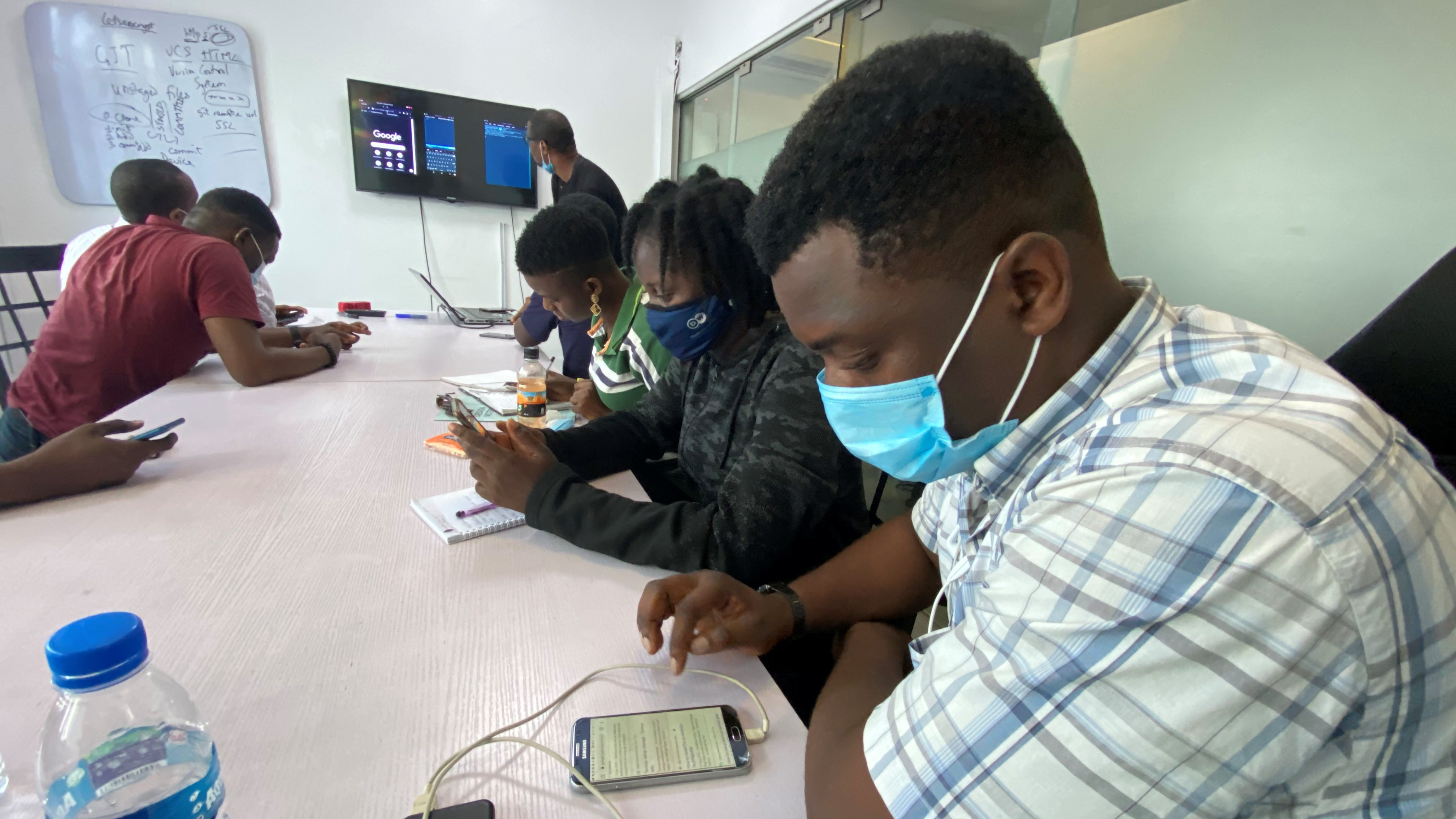 People use their phones during a coding training class in Lagos, Nigeria.