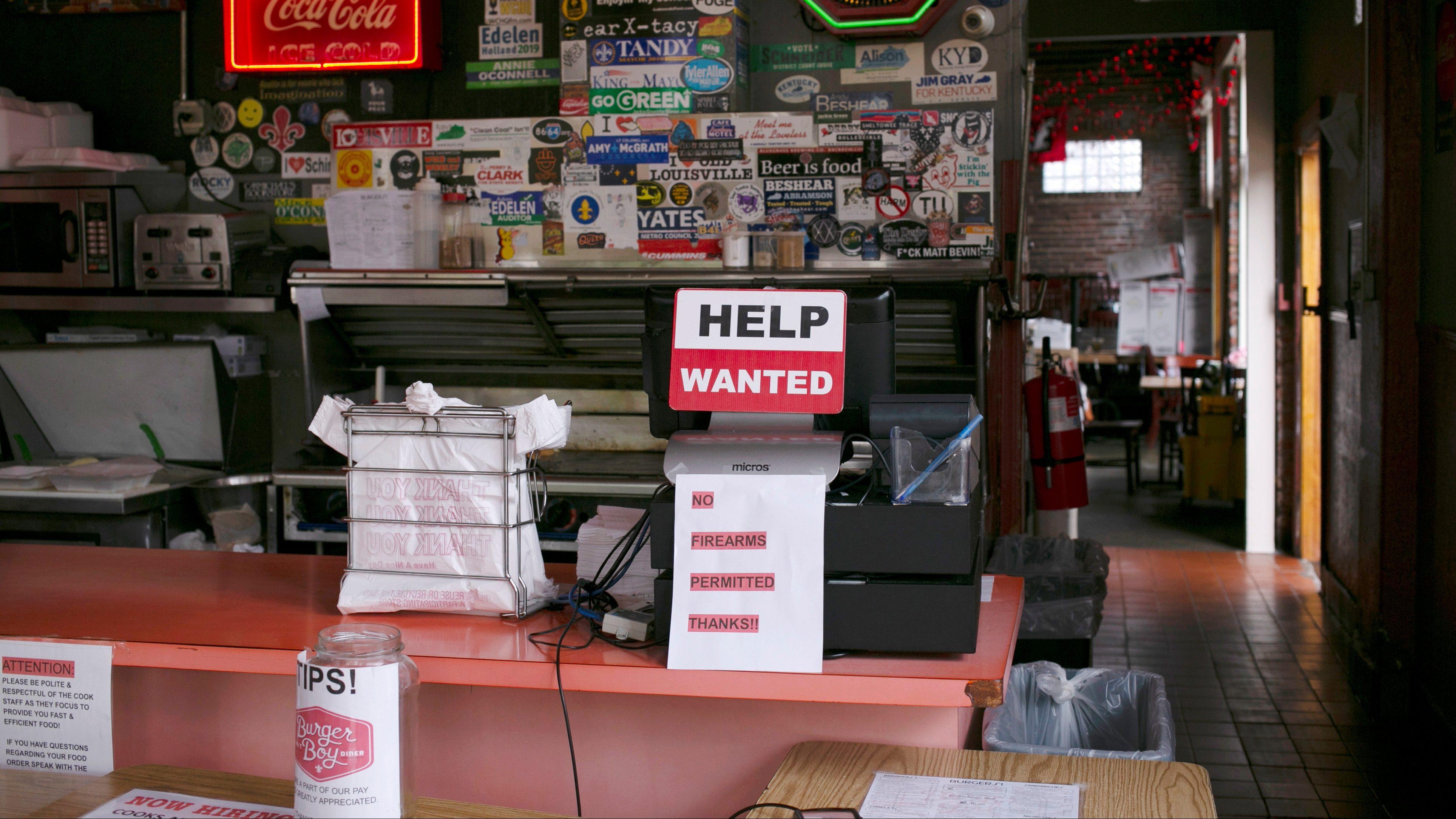 A hiring sign is seen at the register of Burger Boy restaurant.