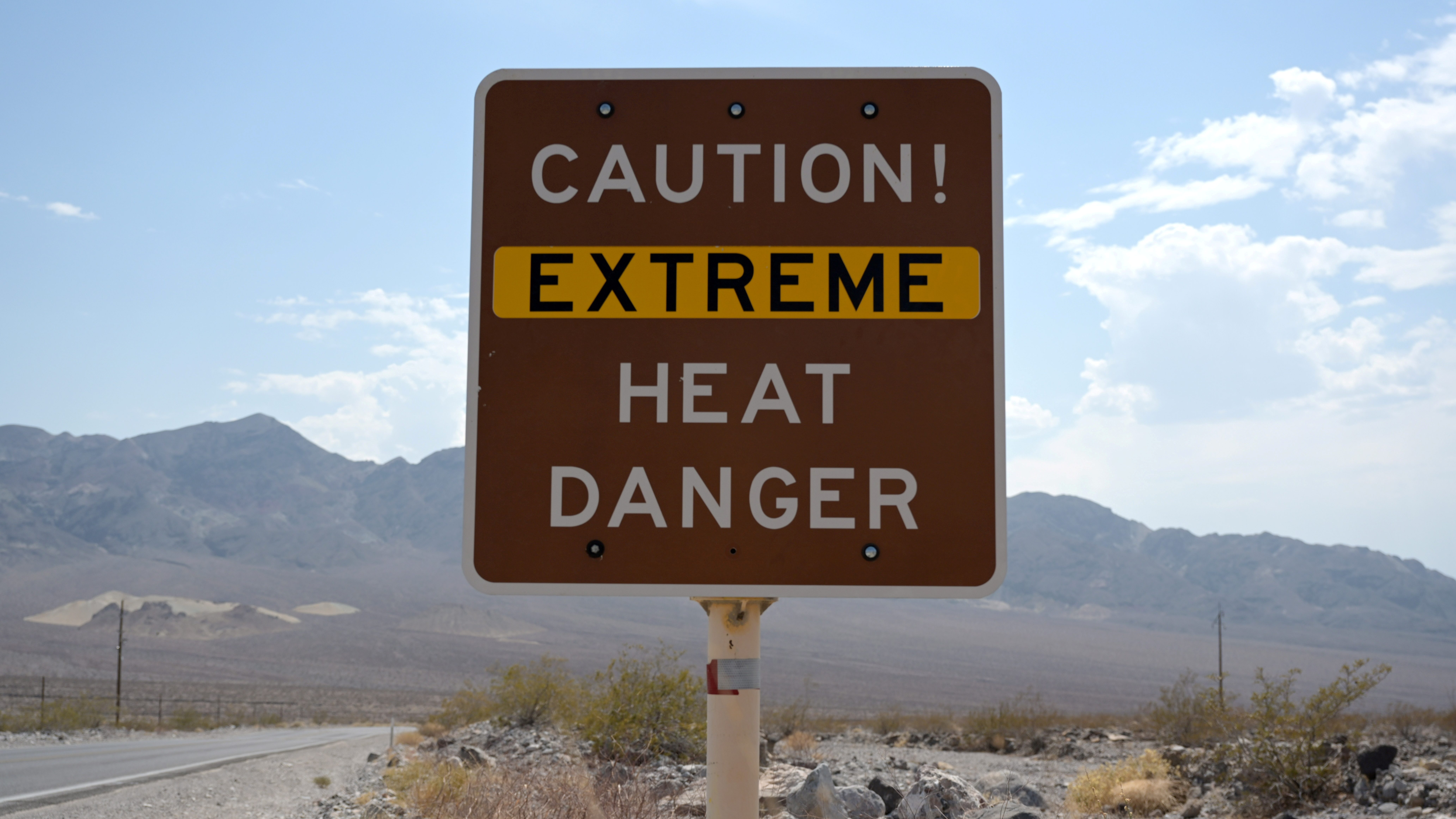 A sign warns of extreme heat in Death Valley