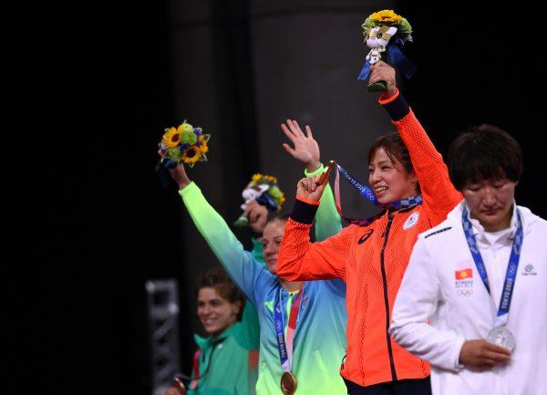 Gold medalist Yukako Kawai of Japan, silver medalist Aisuluu Tynybekova of Kyrgyzstan, bronze medalist Iryna Koliadenko of Ukraine, and bronze medalist Taybe Yusein of Bulgaria react during the medal ceremony