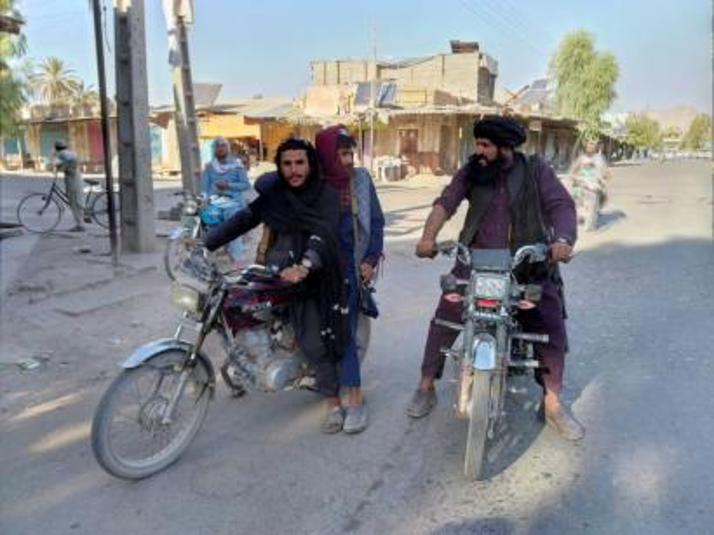Taliban fighters patrol Farah, Afghanistan