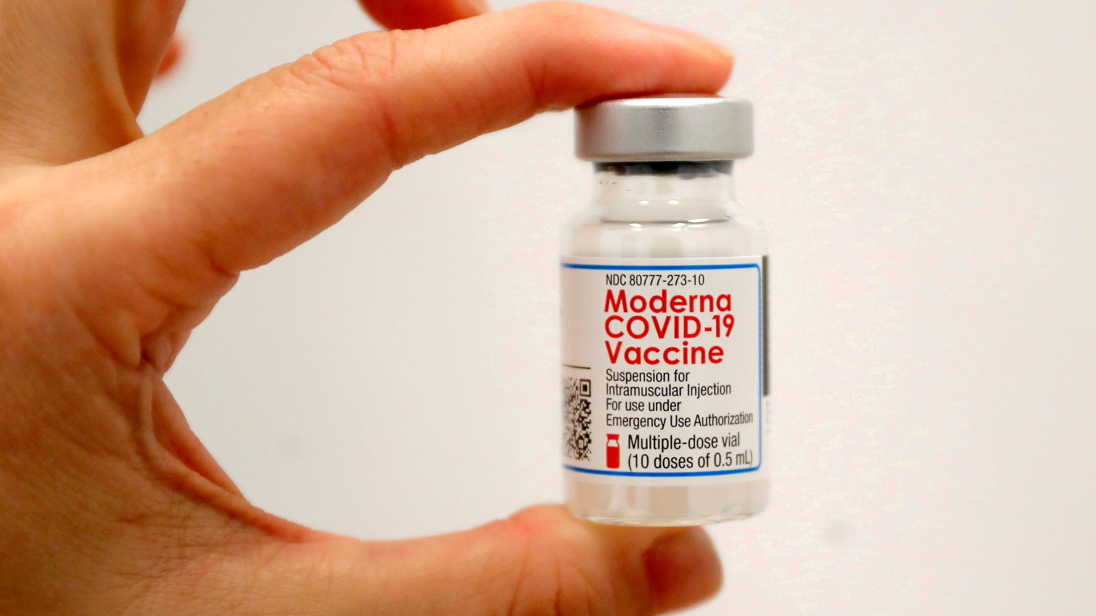 A healthcare worker holds a vial of the Moderna COVID-19 Vaccine at a vaccination site in New York