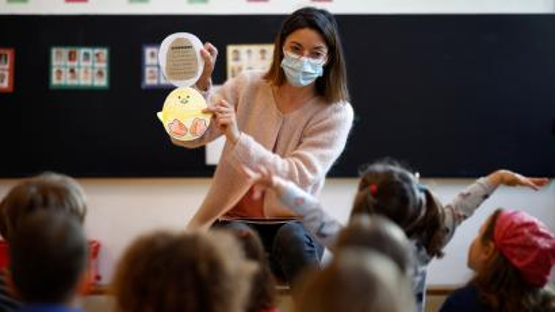 teacher wearing face mask in classroom