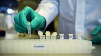 An employee of German biopharmaceutical company CureVac, demonstrates research workflow on a vaccine.