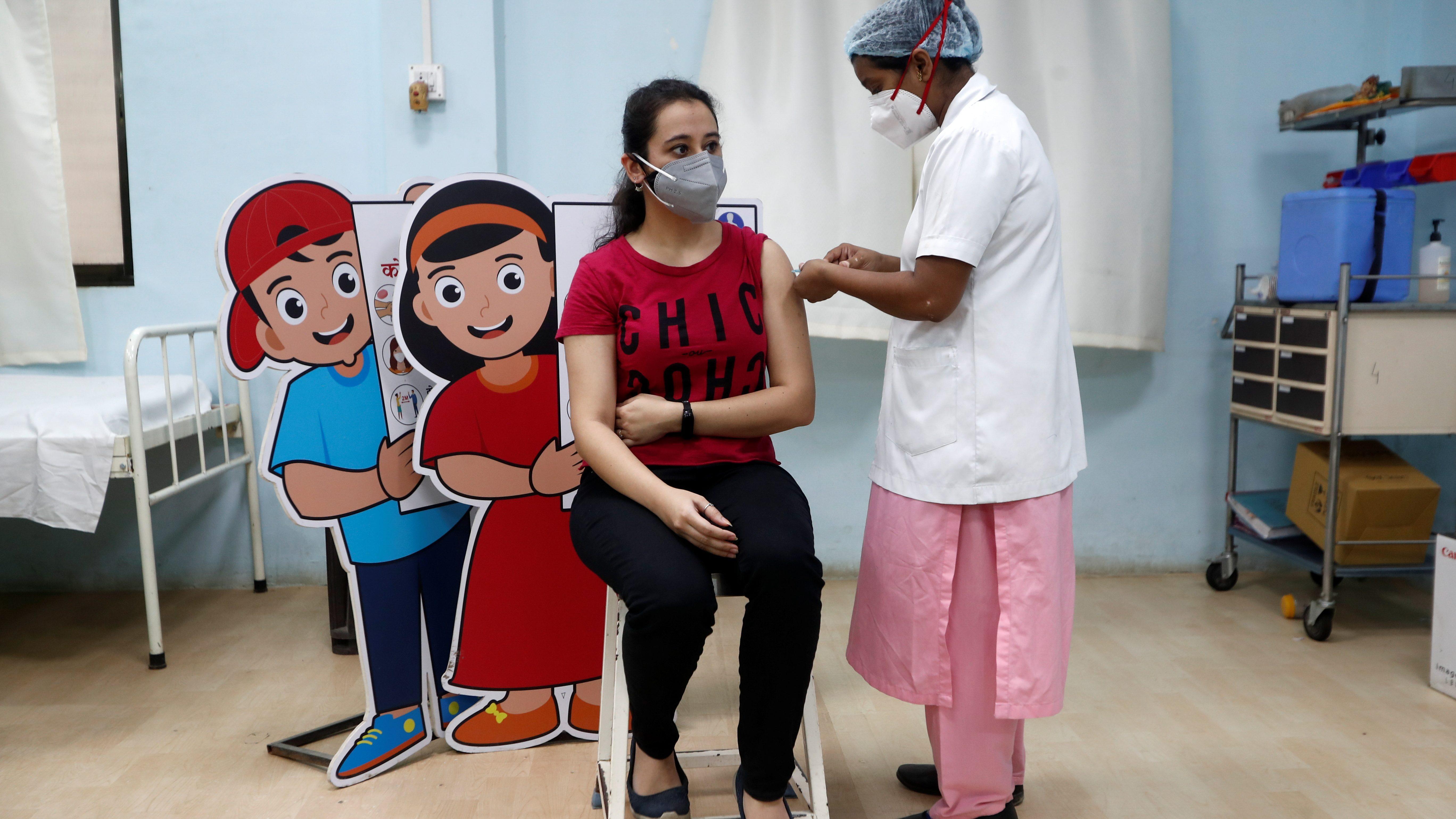 Woman receives a vaccine in Mumbai, India