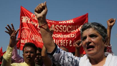 An image of bank employees shouting slogans during an anti-government protest rally
