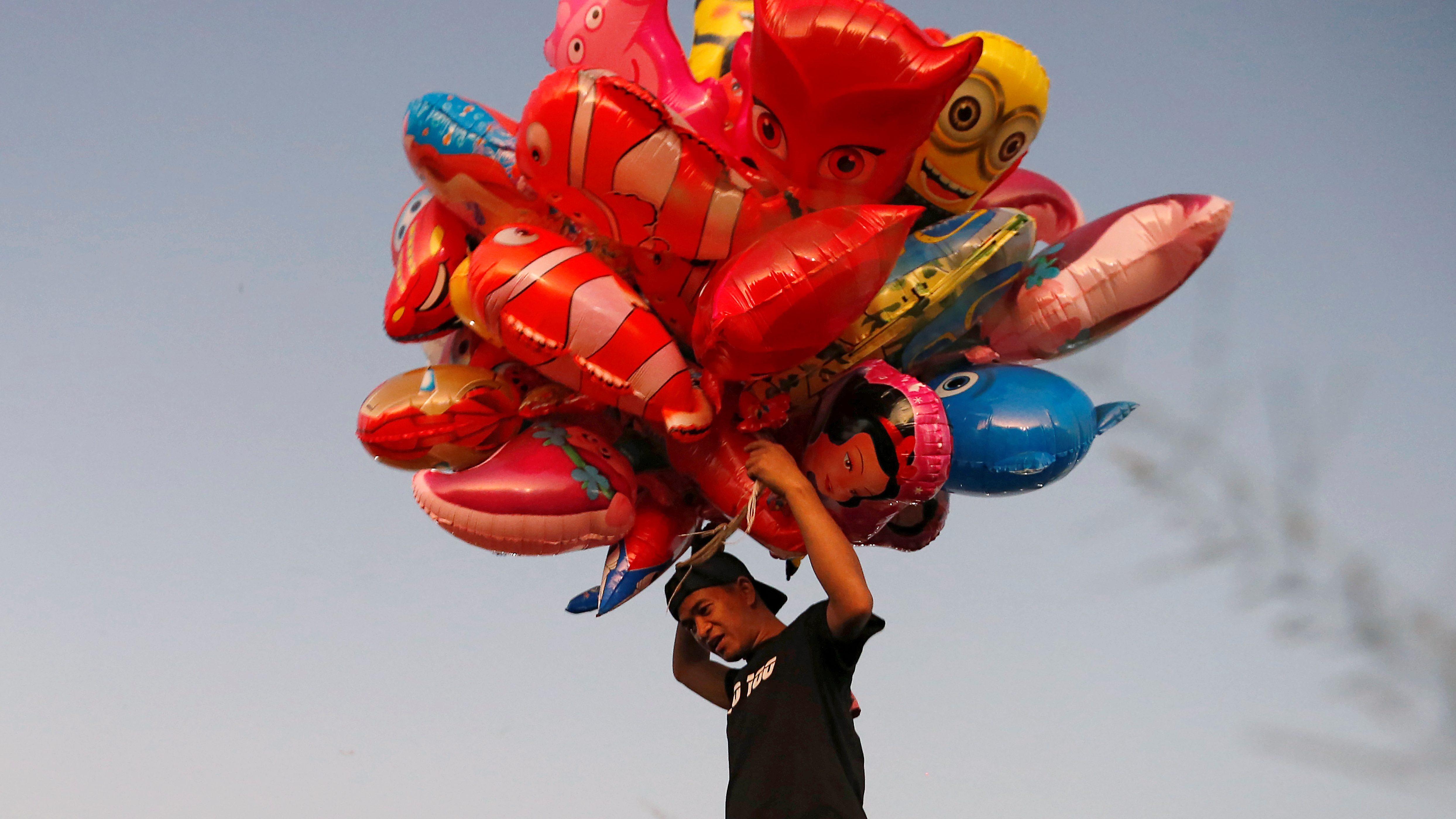 A man sells balloons in Manila