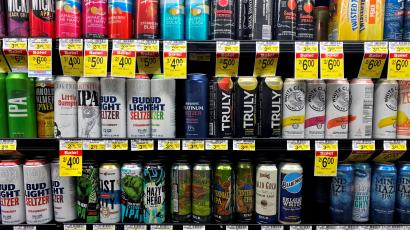 Cans of AB InBev's Bud Light hard seltzer are seen next to White Claw