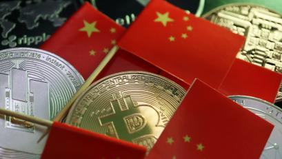 Chinese flags and crypto coins.