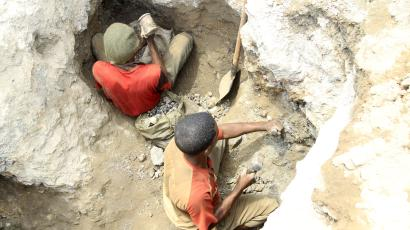 Two artisanal miners work at a cobalt mine-pit in the Democratic Republic of Congo.